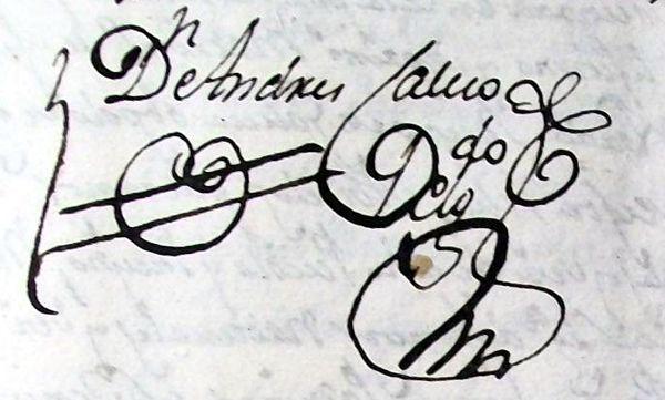 Firma del cura adornada en un libro sacramental antiguo