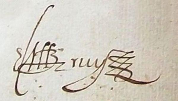 Firma del cura en una partida antigua del siglo XVII